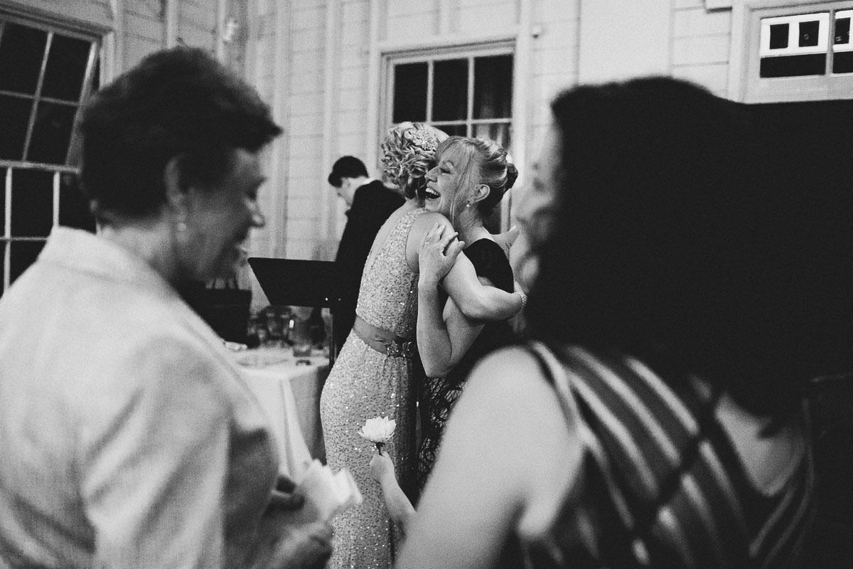 wedding reception hugs