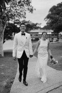 bride & groom smiling at guests