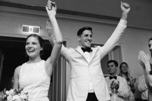 bride & groom entering wedding reception