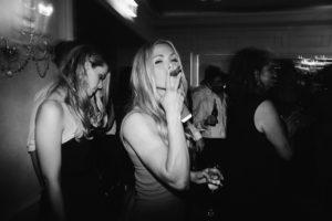 cool girl smoking cigar at wedding