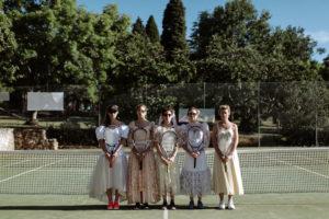 bridesmaids vintage wedding dresses playing tennis