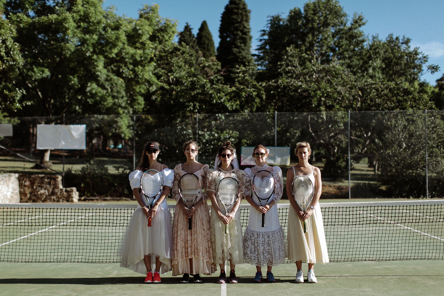 bridesmaids vintage wedding dresses playing tennis