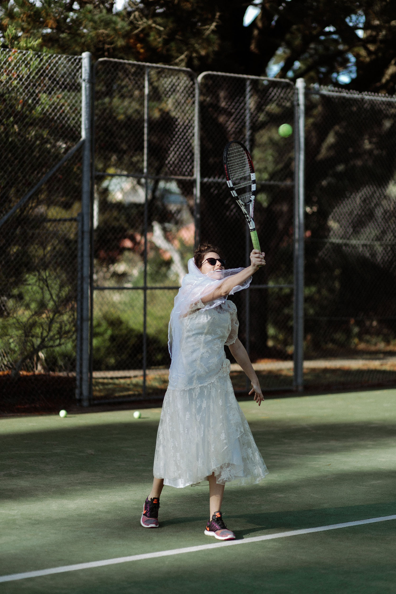 bride vintage wedding dress playing tennis