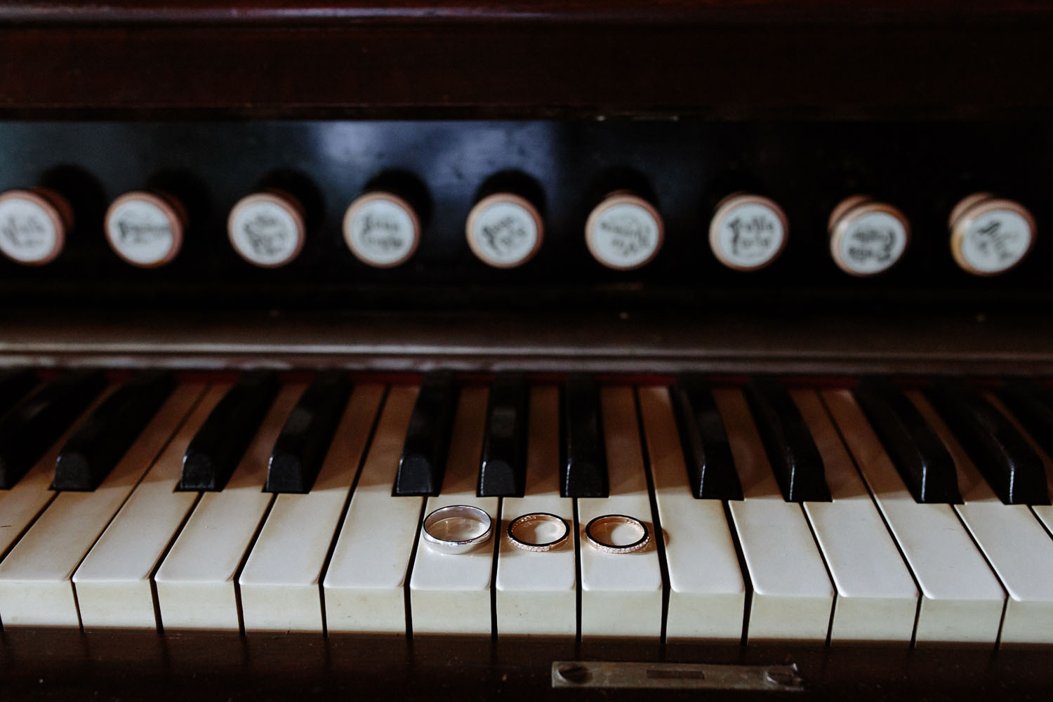 wedding rings on piano keys