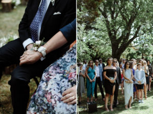 wedding guests holding hands