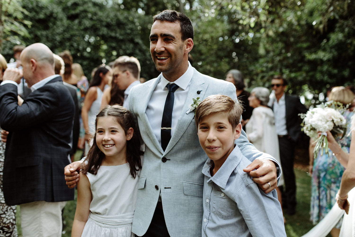 groom laughing with kids