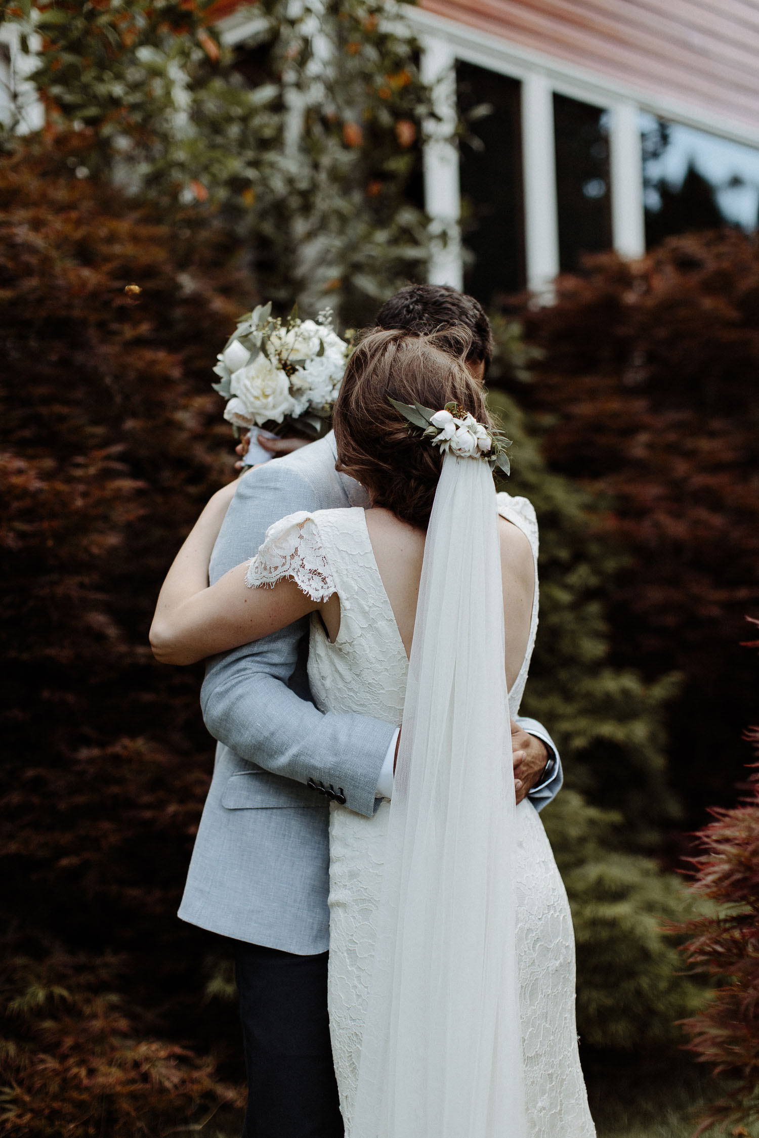 bride groom hugging autumn leaves