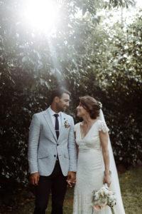 bride and groom sun flare