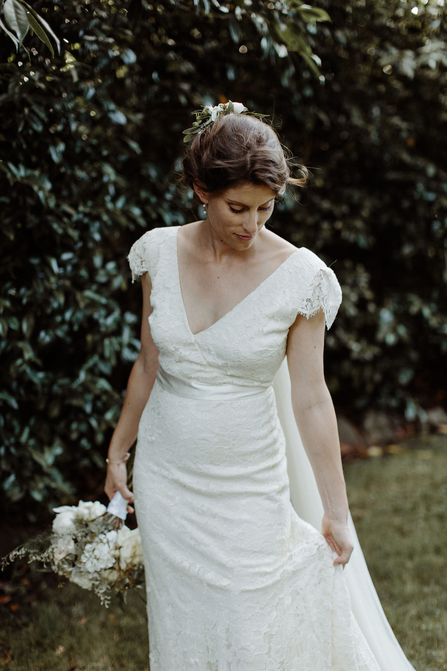 bride portrait holding dress