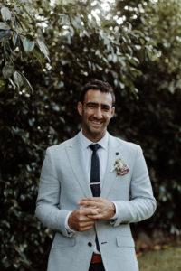 groom portrait laughing
