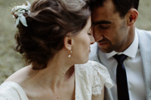 bride and groom touching heads peacefully