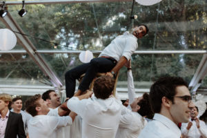 jewish wedding groom on chair during hora