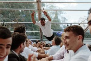 jewish wedding hora groom thrown in air