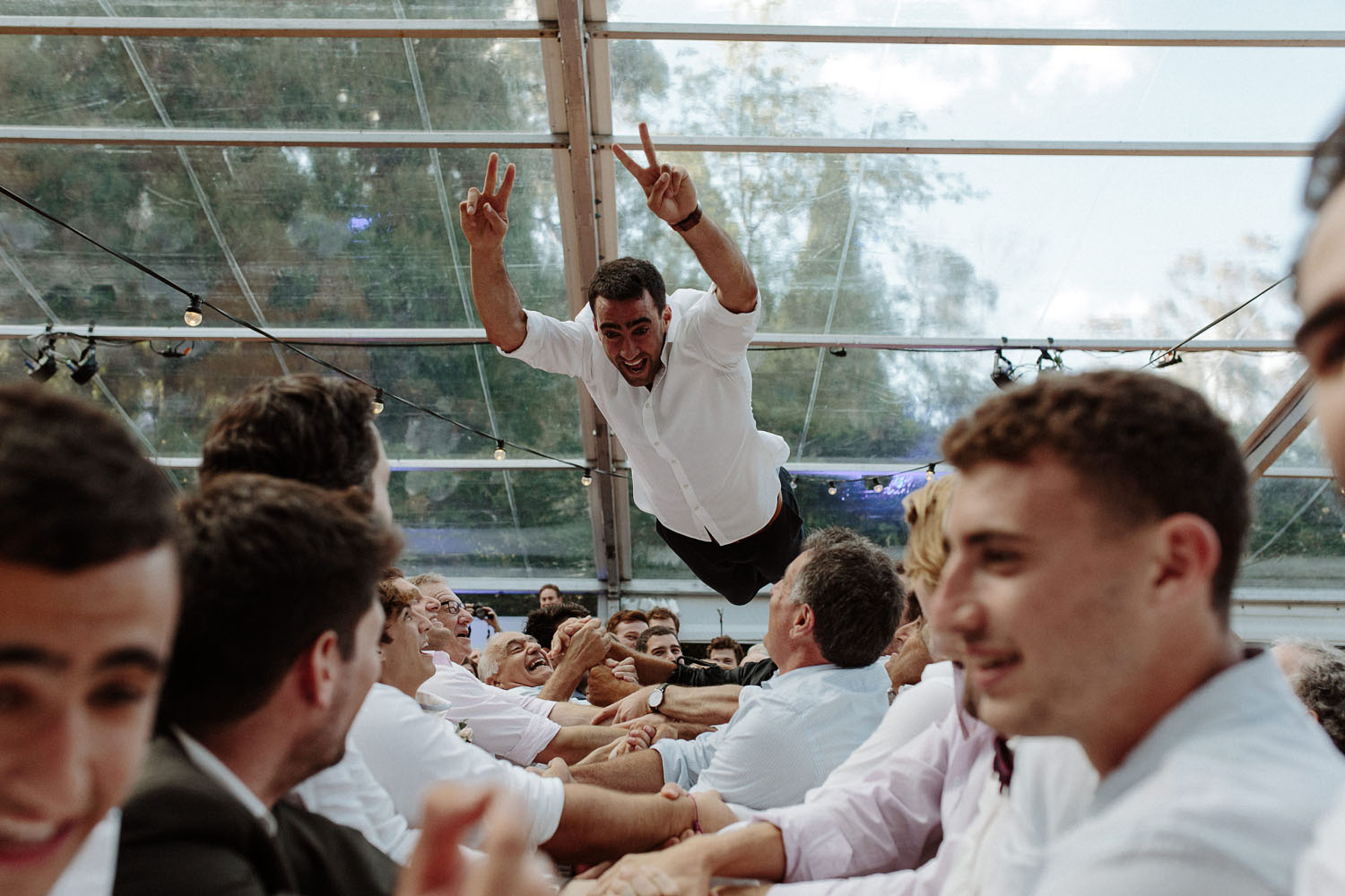 jewish wedding hora groom thrown in air