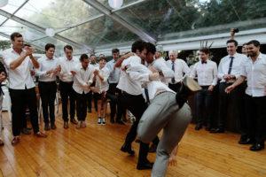 guests dancing hora jewish wedding