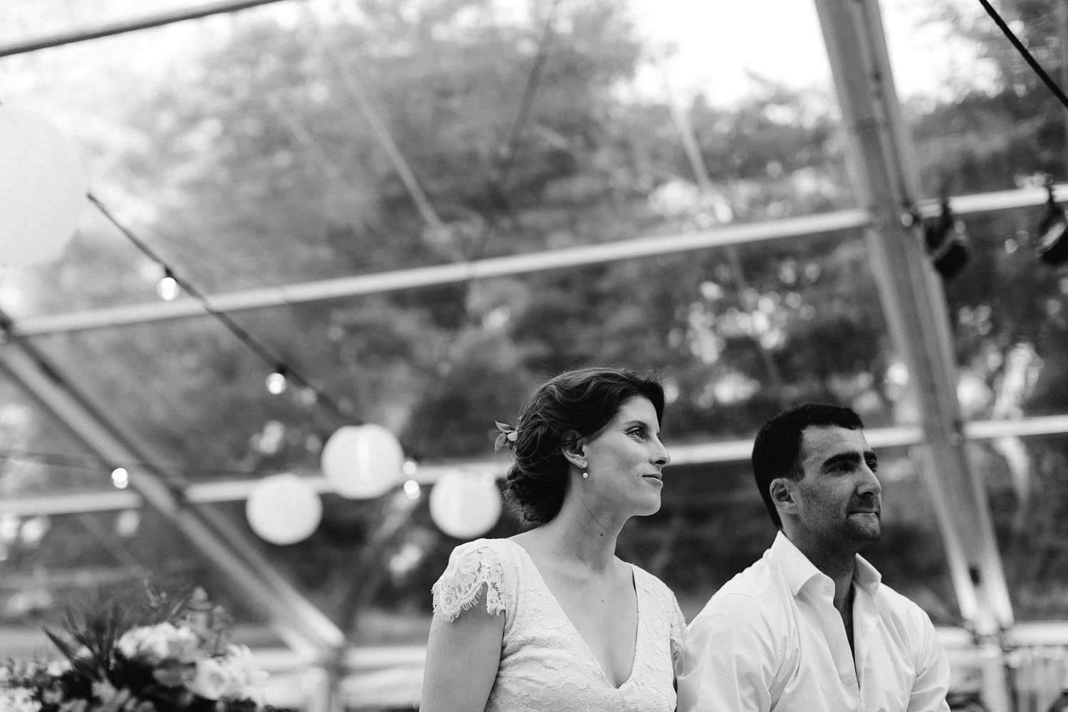 bride and groom watch wedding speeches