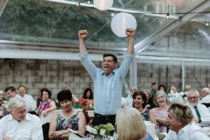 guest cheers during wedding speech