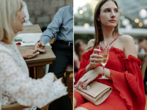 guests hold hands at wedding