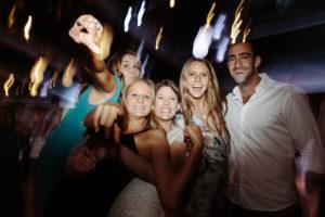 wedding guests laughing on dancefloor