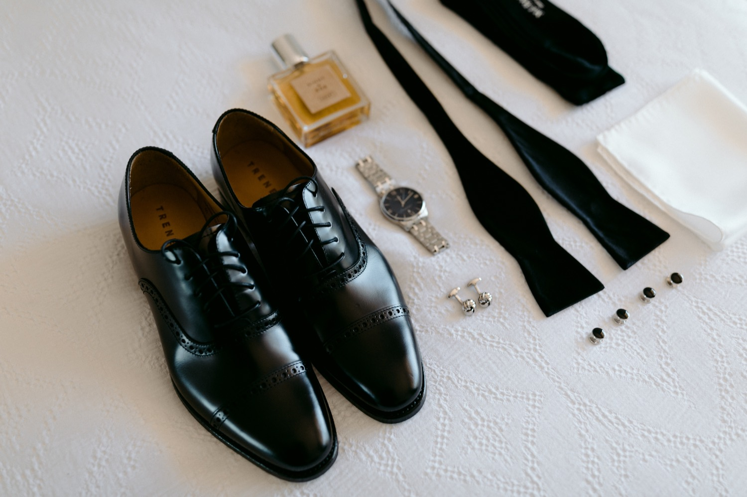 collection of stylish black tie groom details