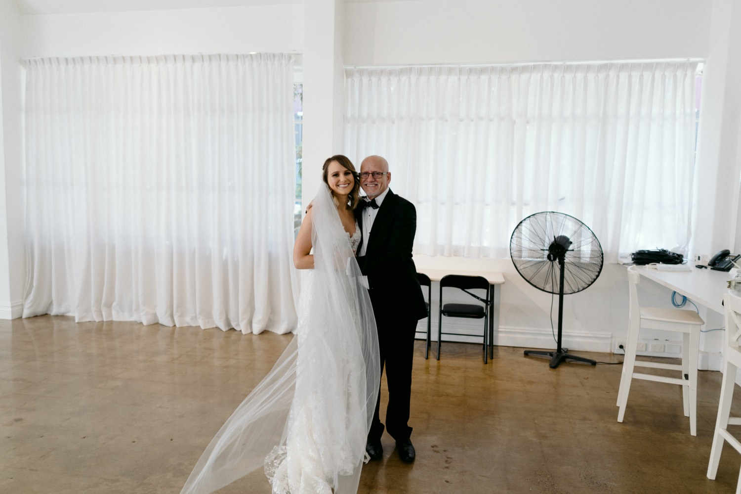 bride and father hugging before wedding ceremony at la porte space