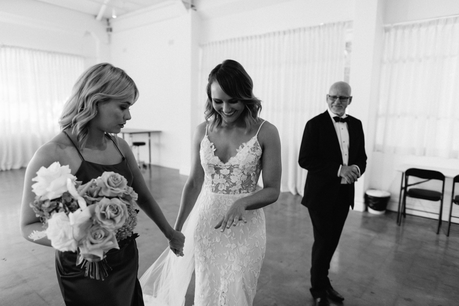 bride showing bridesmaid her shaking hands