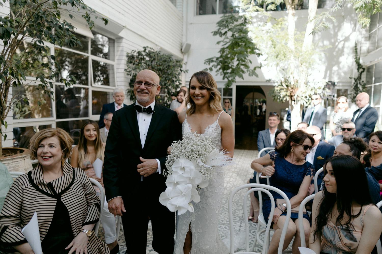bride entering la porte space ceremony