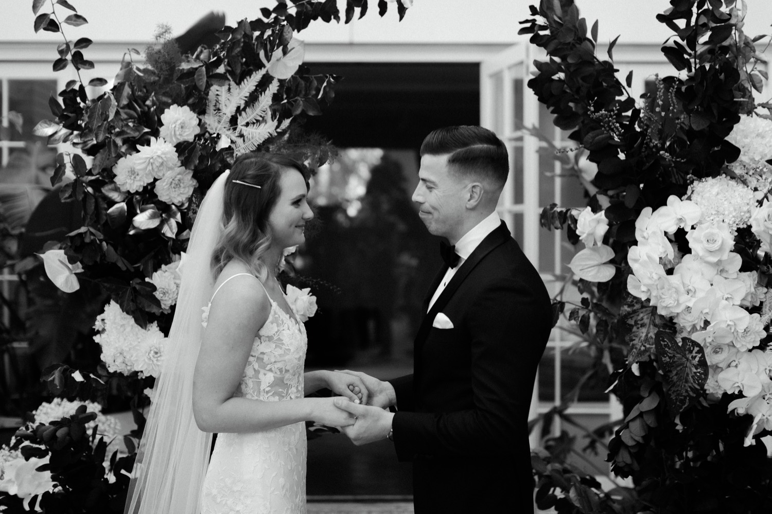bride and groom looking lovingly at each other mid-ceremony