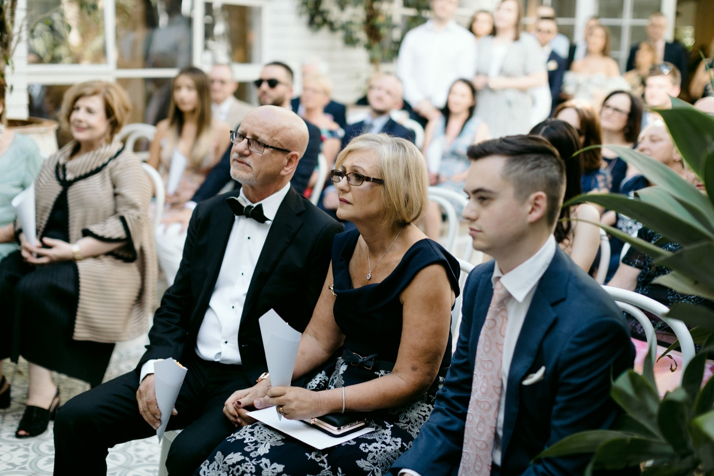 brides parents sat watching the ceremony
