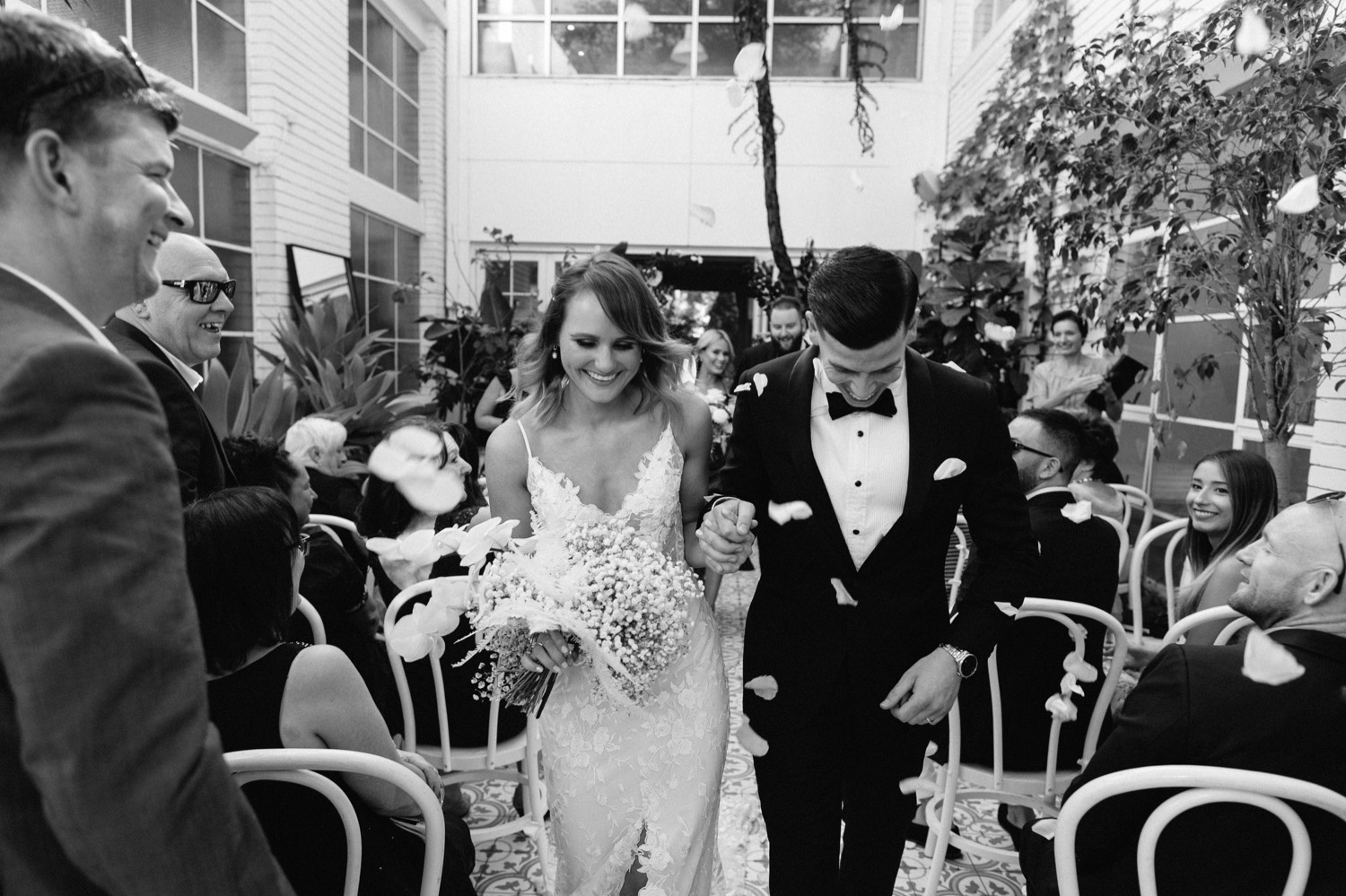 fun shot of bride and groom exiting down the aisle after the ceremony