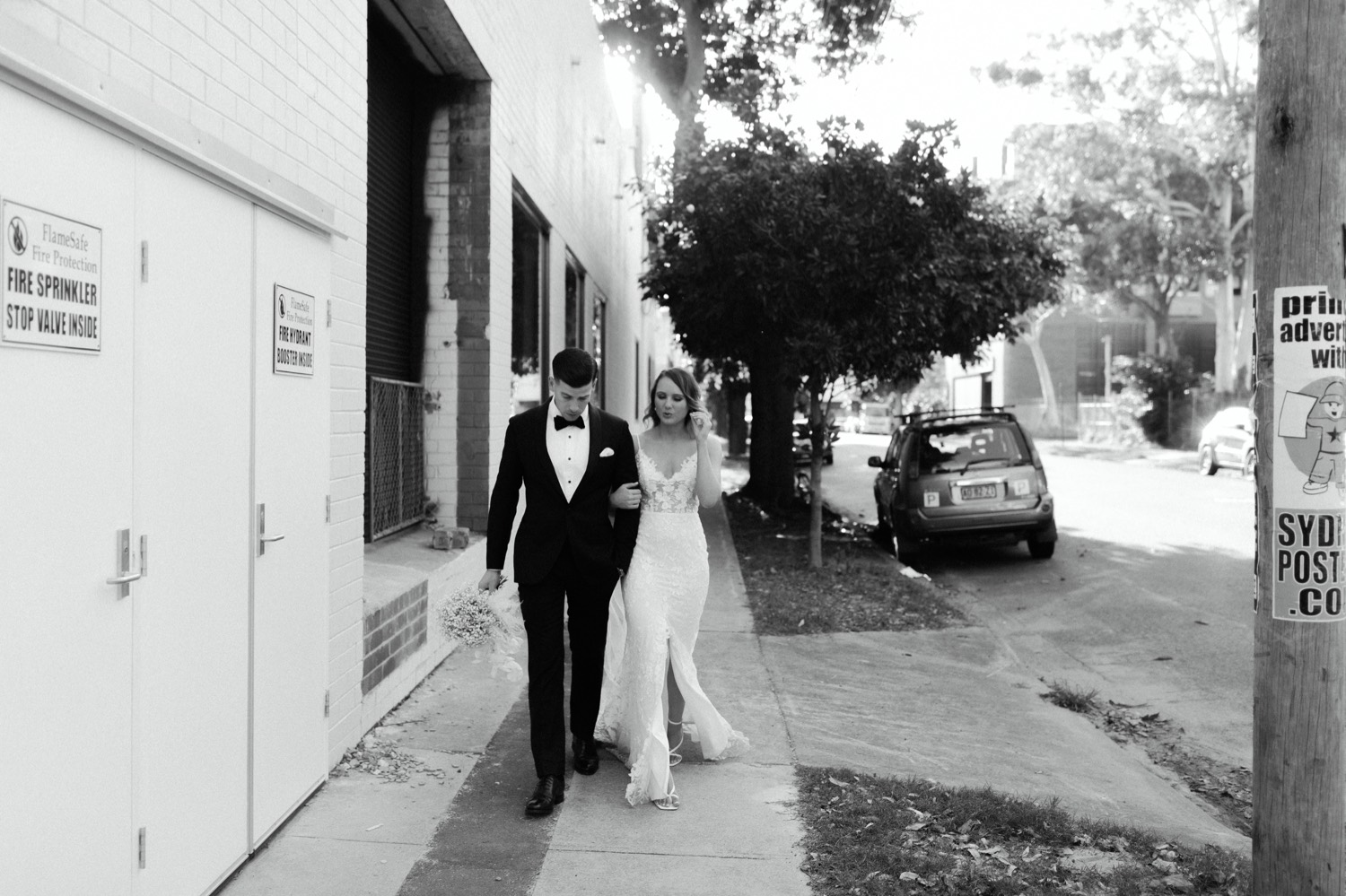 couple taking a relaxed walk along the streets of rosebery