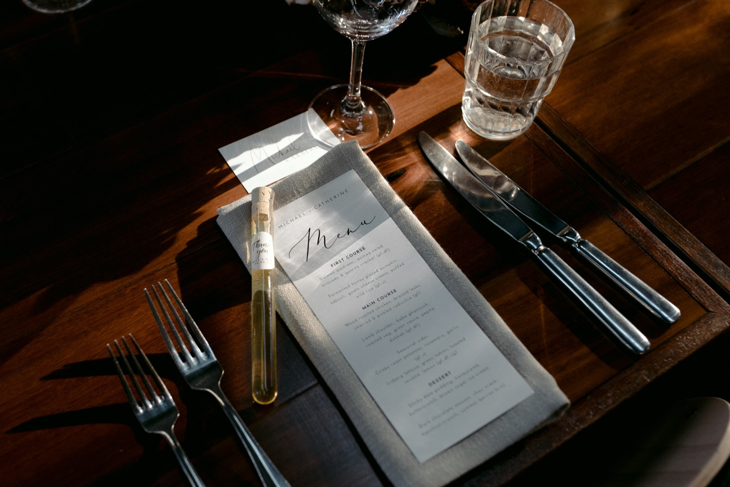 close up of place setting at three blue ducks with gentle sun through window