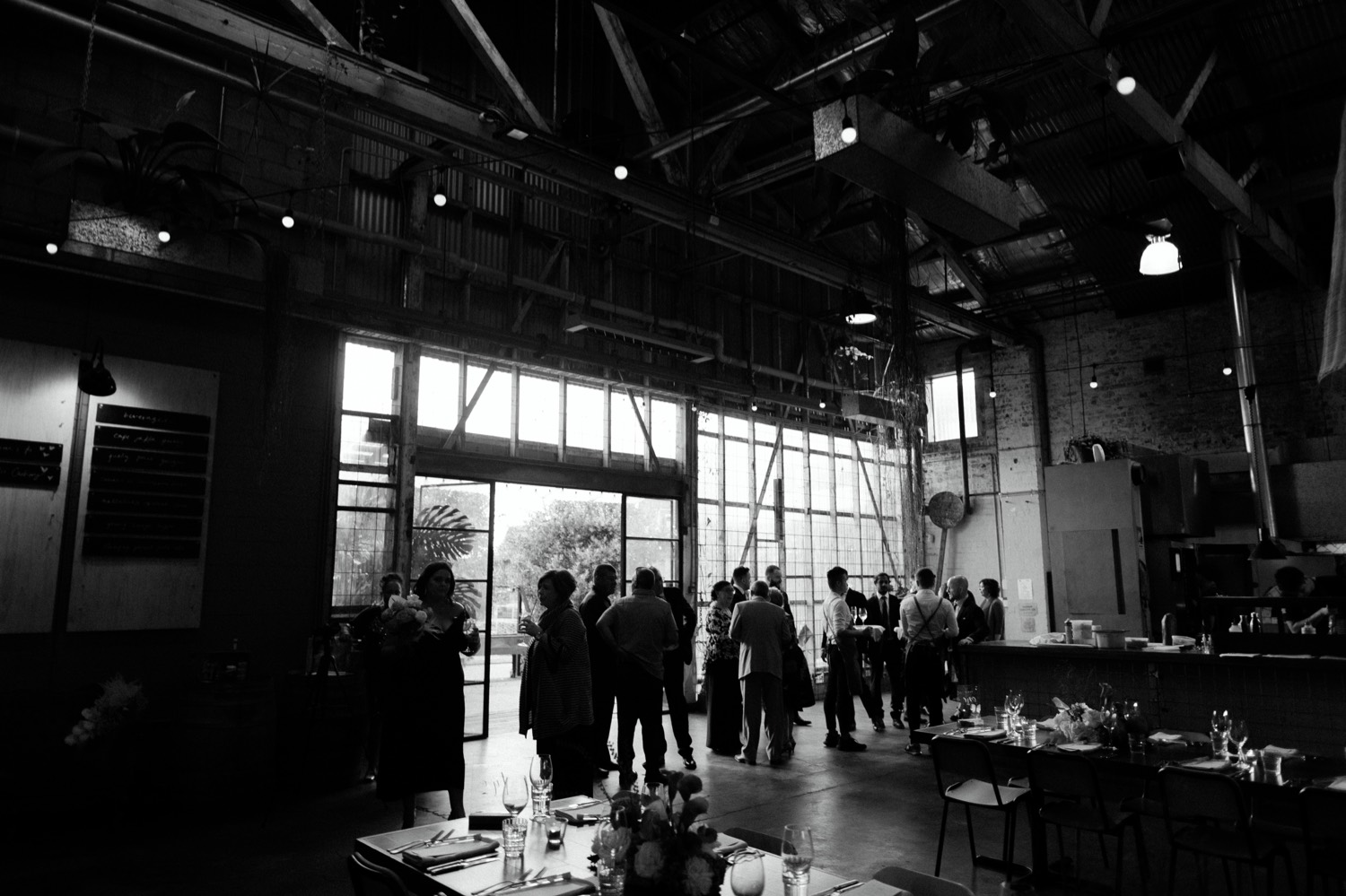 wide shot of three blue ducks rosebery showing guests during cocktail hour