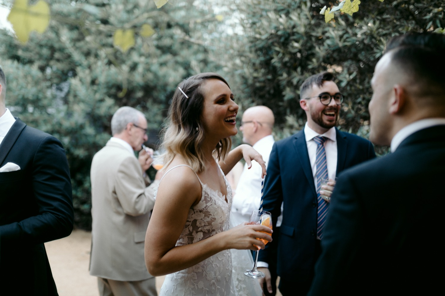 bride laughing during cocktail hour