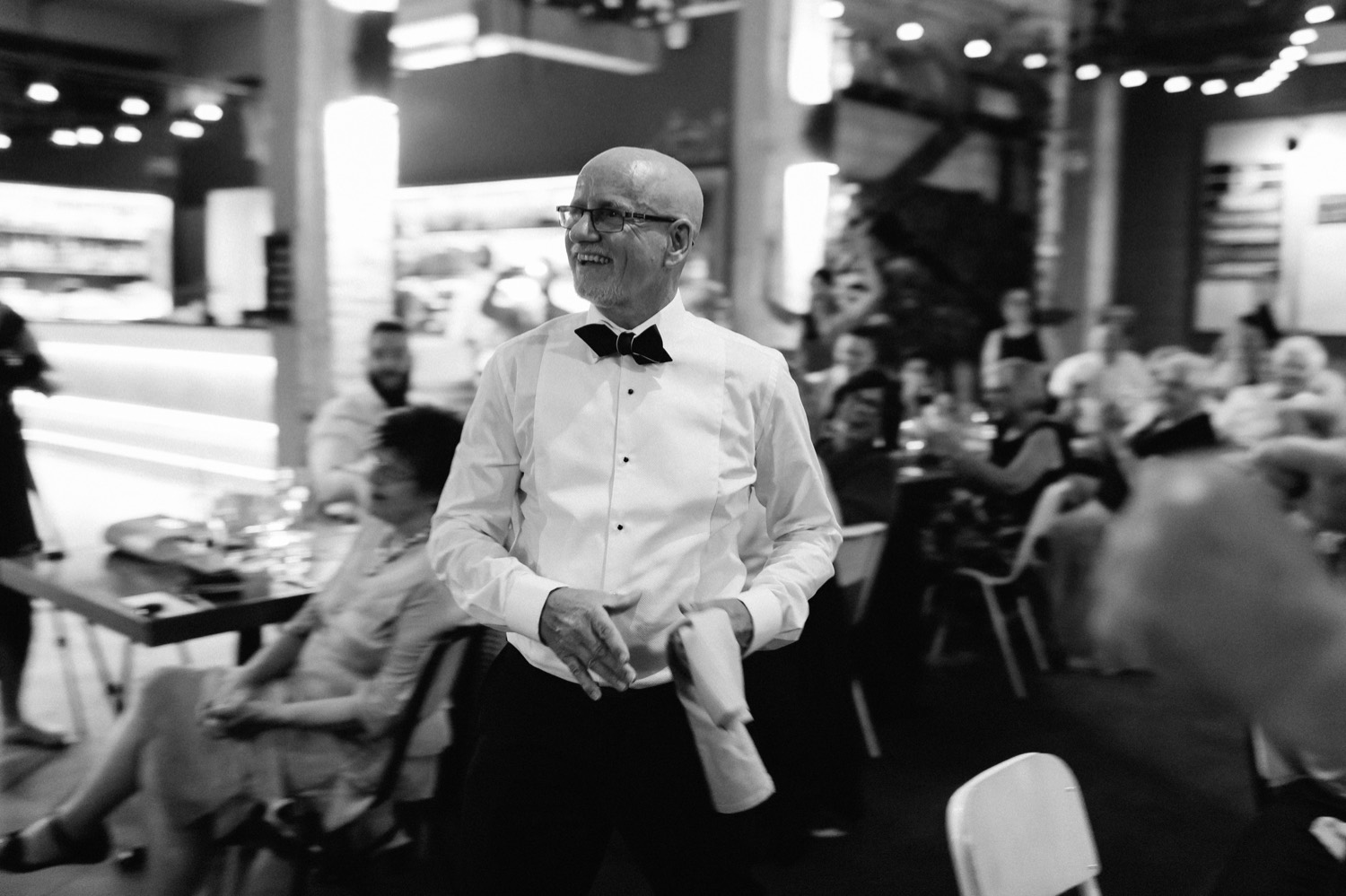 father of the bride walking up to make a speech at three blue ducks