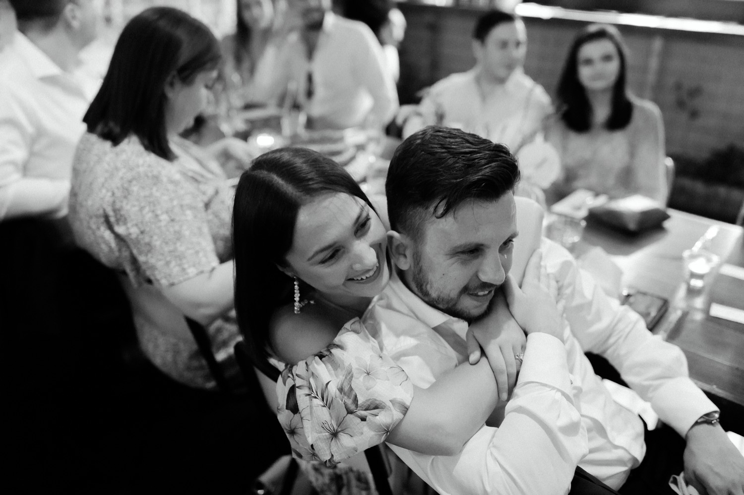wedding guests hugging during the wedding speeches