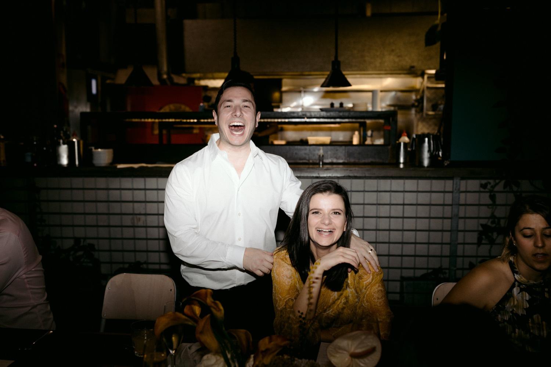 wedding guests laughing at camera