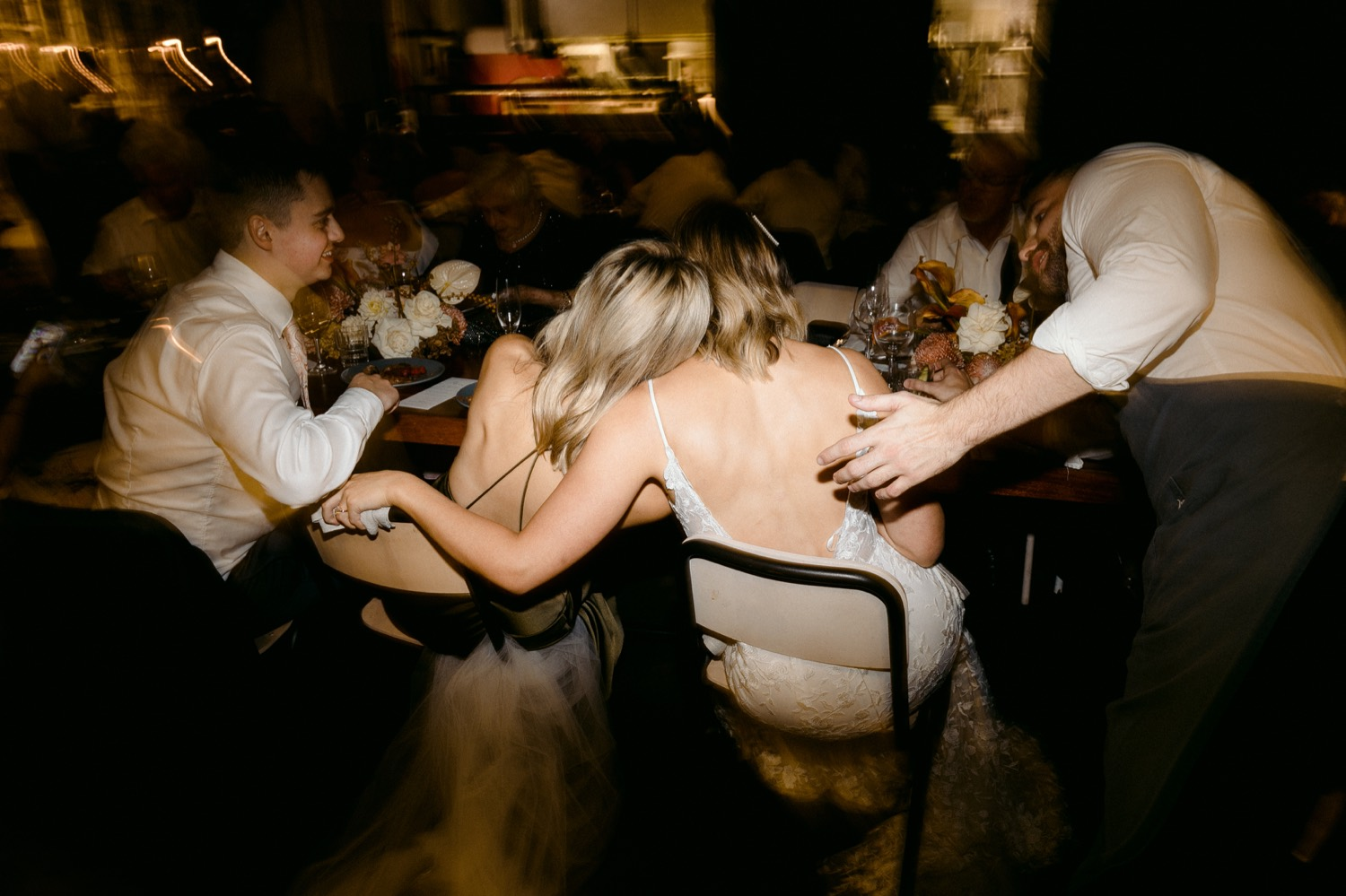 bride and her sister share a tender embrace at three blue ducks sydney