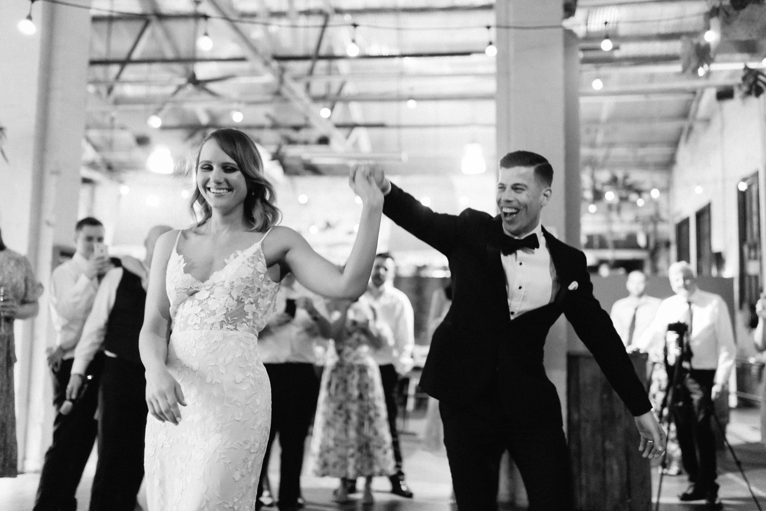 groom spinning the bride round during their first dance