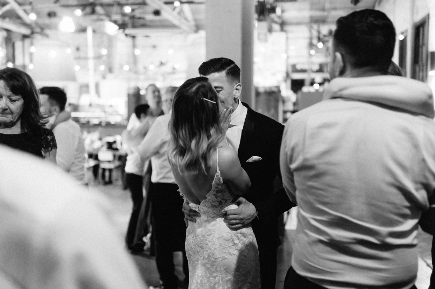 couple sharing a passionate kiss on a packed dancefloor