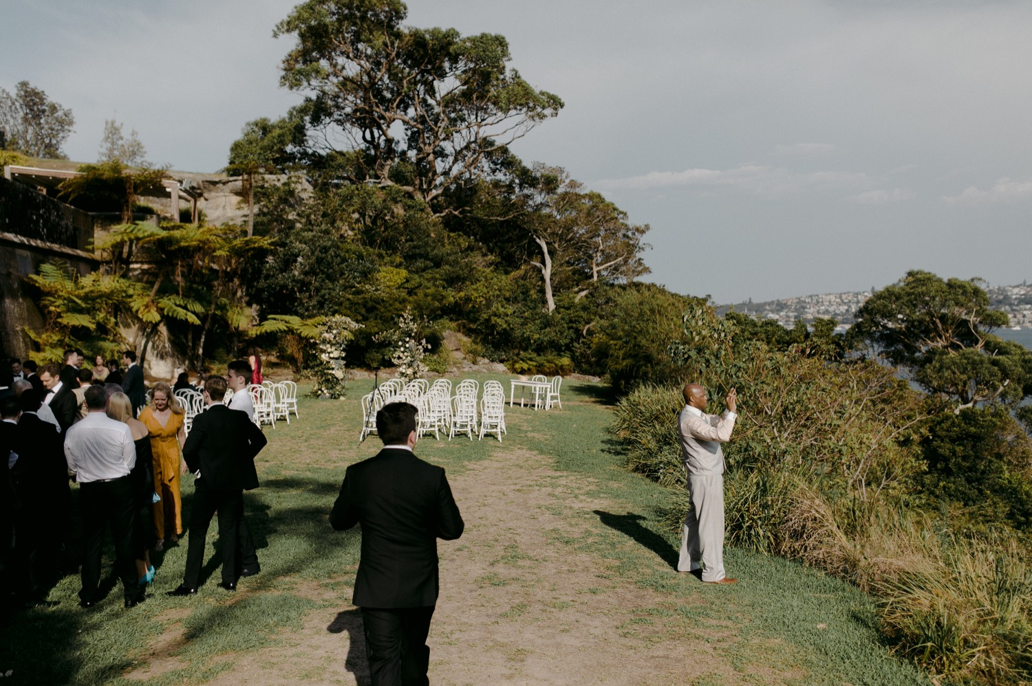 wedding guest taking photo of sydney harbour