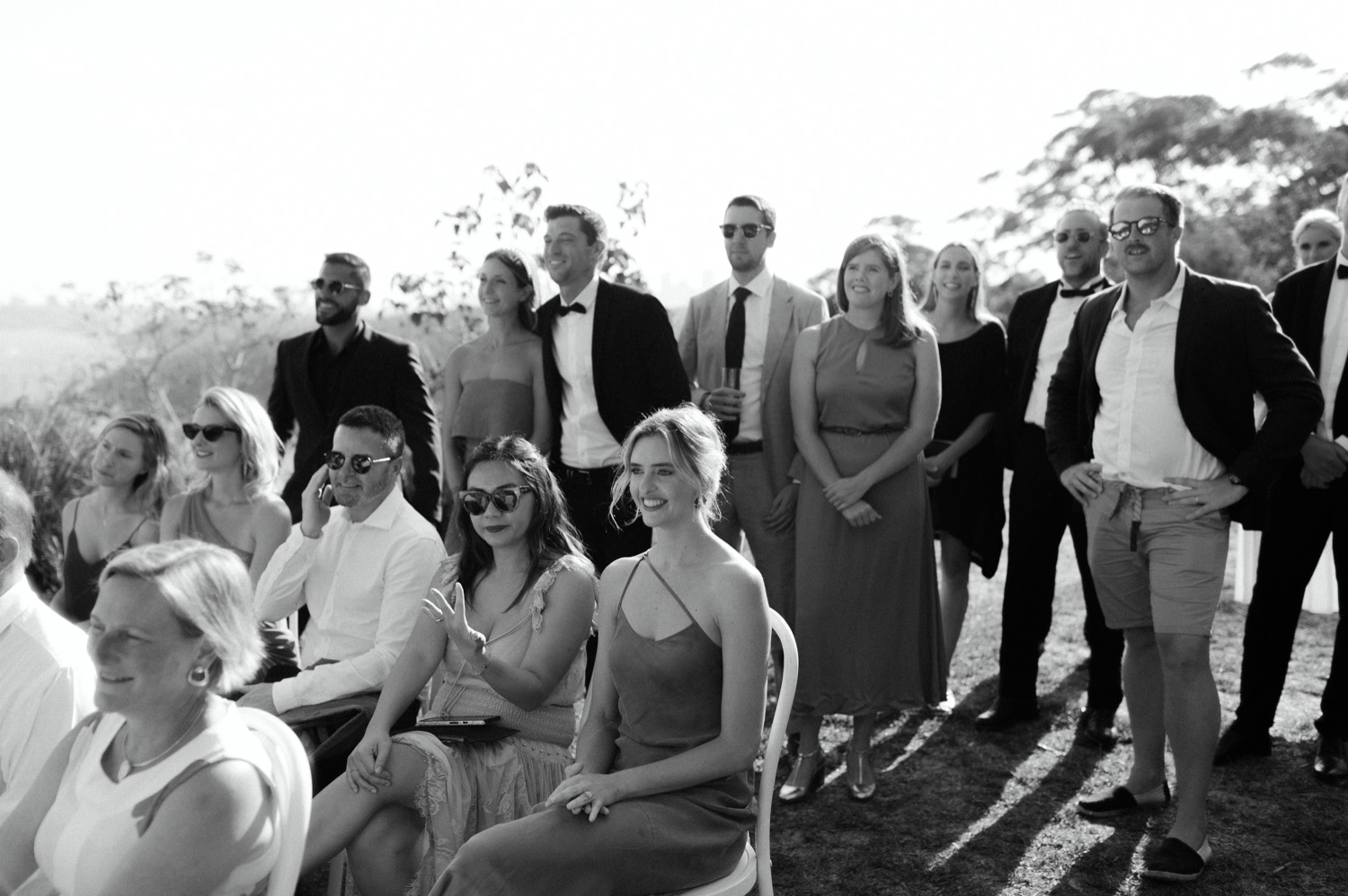 black and white shot of wedding guests at ceremony