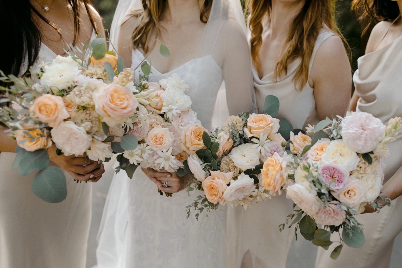 pastel toned bridesmaid flowers