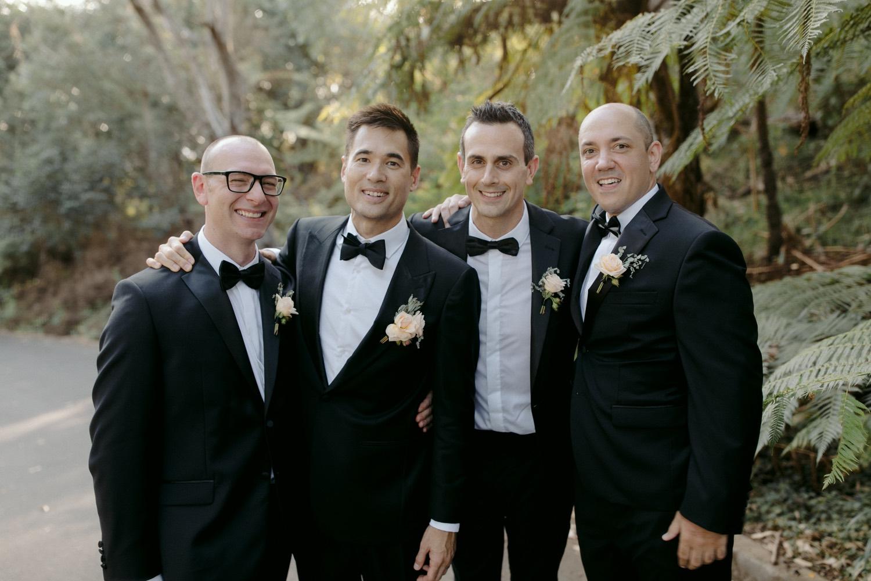 groom and groomsmen in black tie