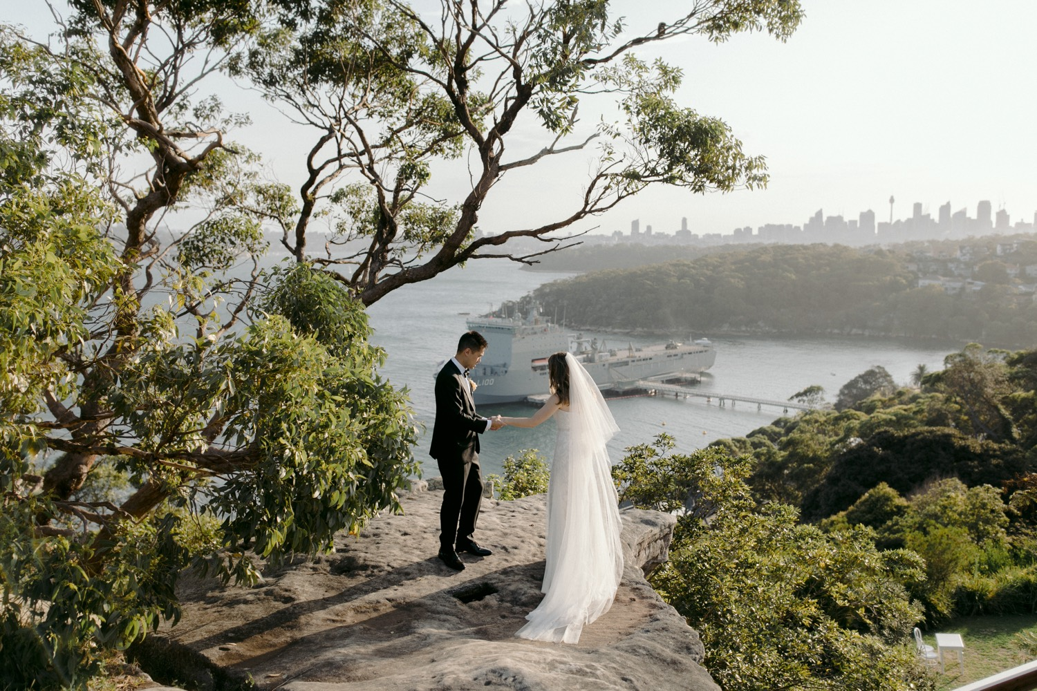 bride and groom looking out over georges head