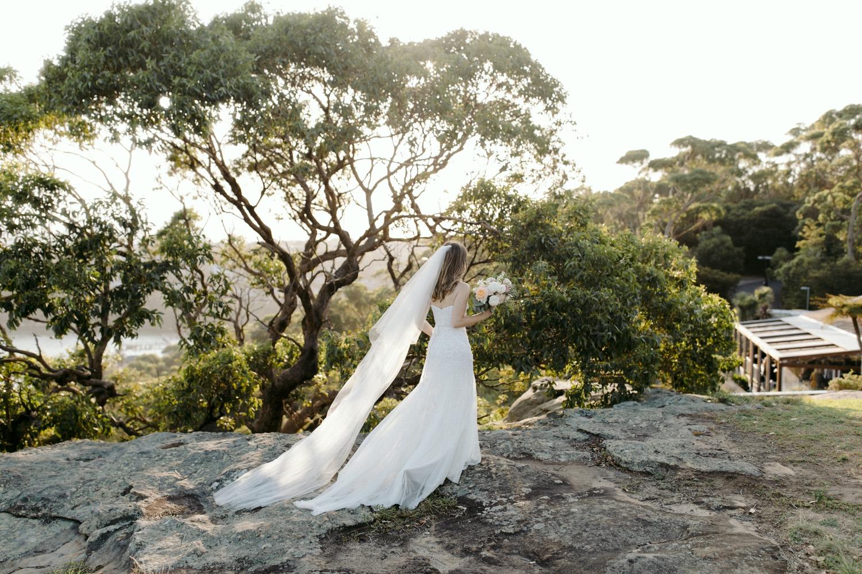 bride walking over rocks at gunners barracks