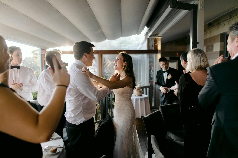 bride and groom entering reception celebration