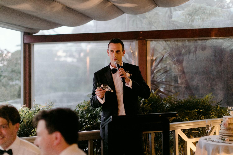 groomsman delivering wedding speech