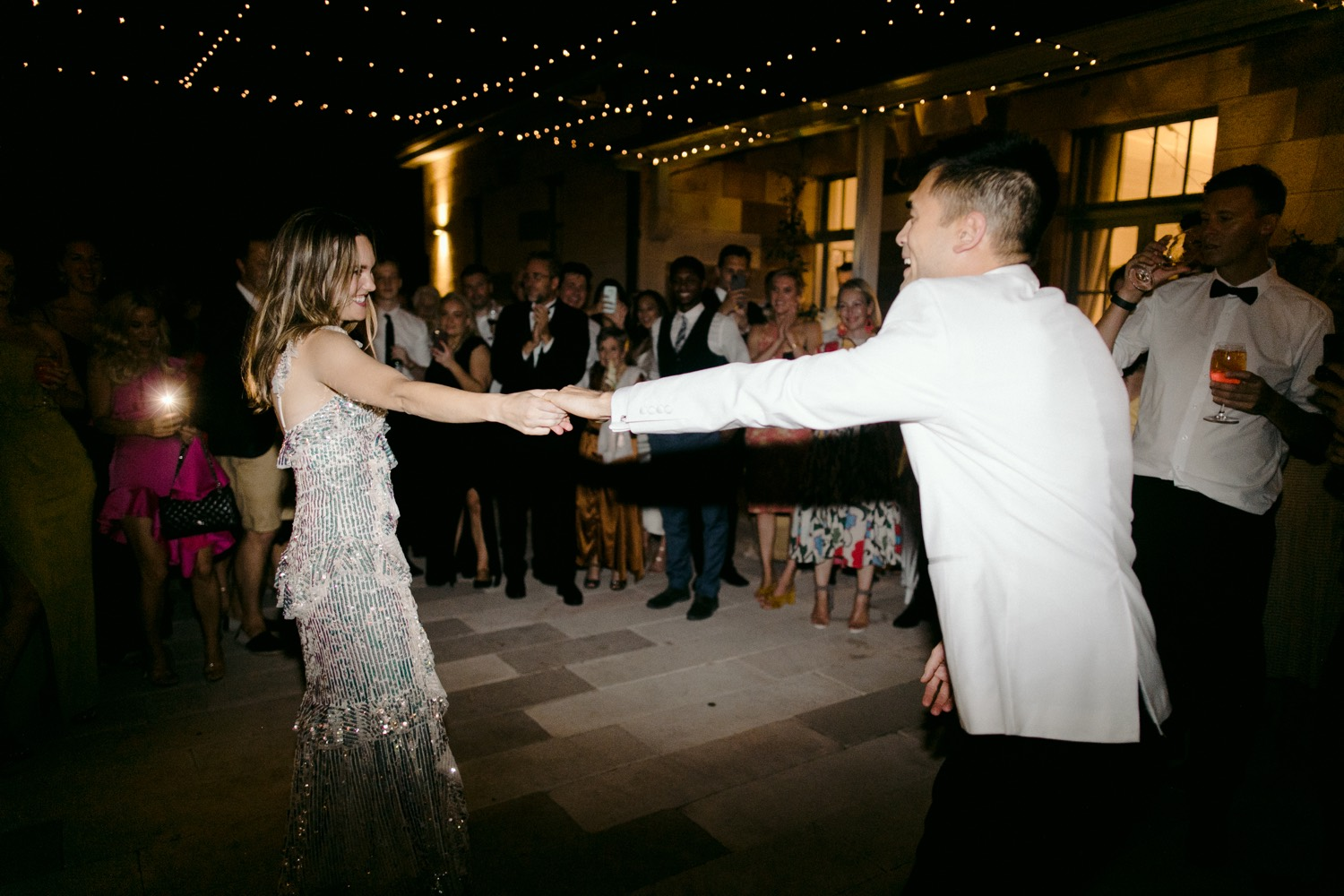 groom spinning bride around during first dance