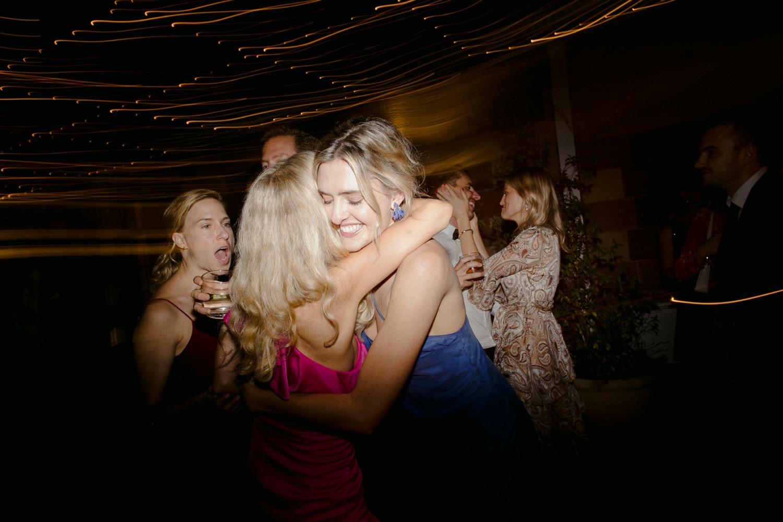 wedding guests hugging on the dance floor